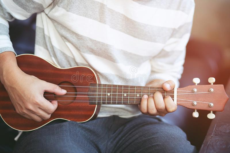 Young men are playing guitar for fans to listen to in restaurants. stock image