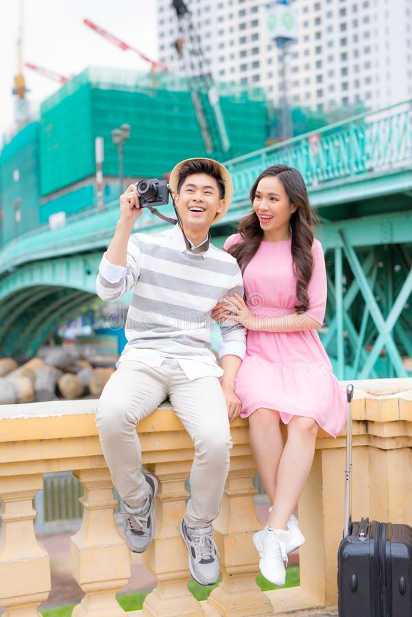 Young man and pretty girl are having fun in the city at evening. Young men and pretty girl are having fun in the city at evening stock image