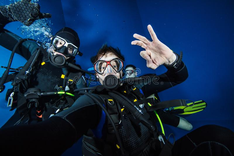 Young men scuba divers making selfie royalty free stock photography