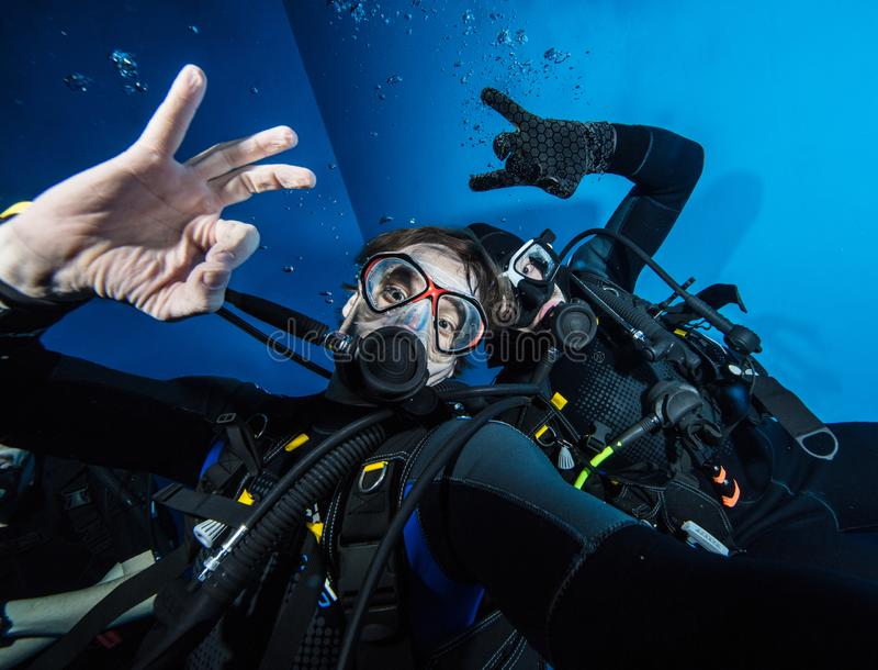 Young men scuba divers making selfie stock photo