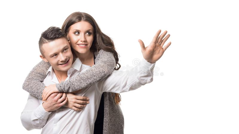Young man shows something to his beloved wife isolated on white background with copy space stock photo