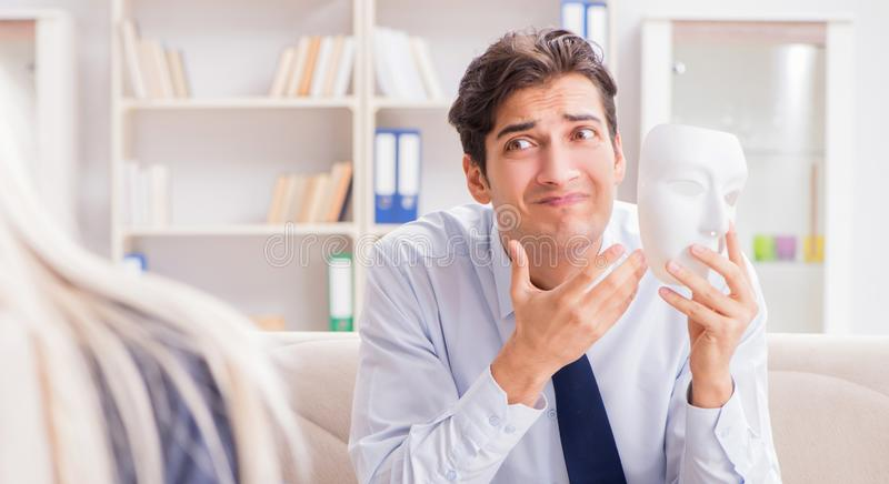 Young man visiting psychiatrist doctor for consultation. The young men visiting psychiatrist doctor for consultation royalty free stock images