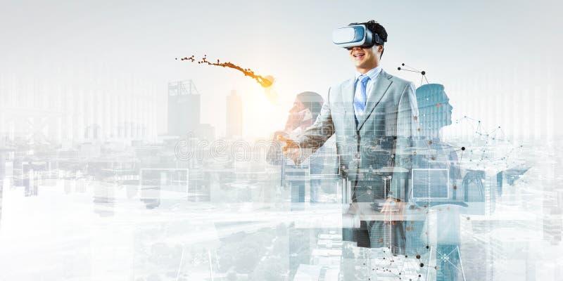 Businessman in virtual mask. Mixed media stock photos