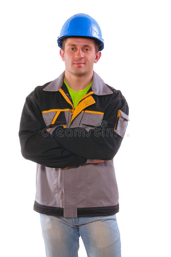 A young men wearing working clothes with crossed arms looking at. A young man wearing working clothes with crossed arms looking at camera isolated on white royalty free stock images