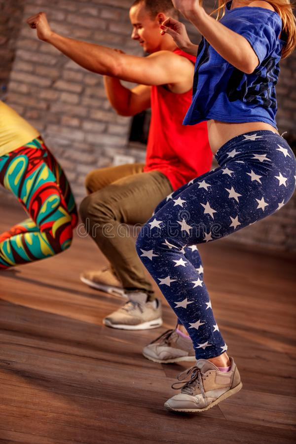 Young men and women dancing Zumba modern group choreography stock images