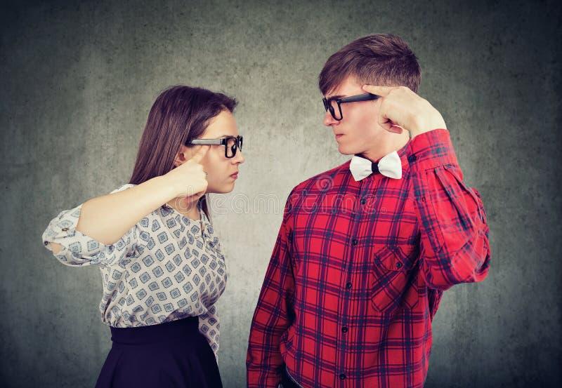 Arguing young couple having quarrel stock photos