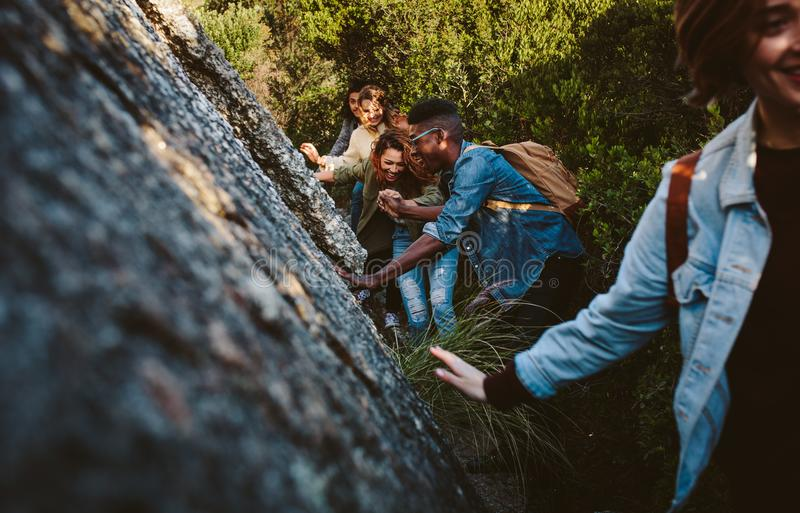 Friends walking through a mountain trail stock photography