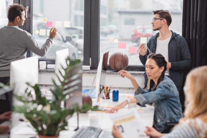 young men and women at work stock photos