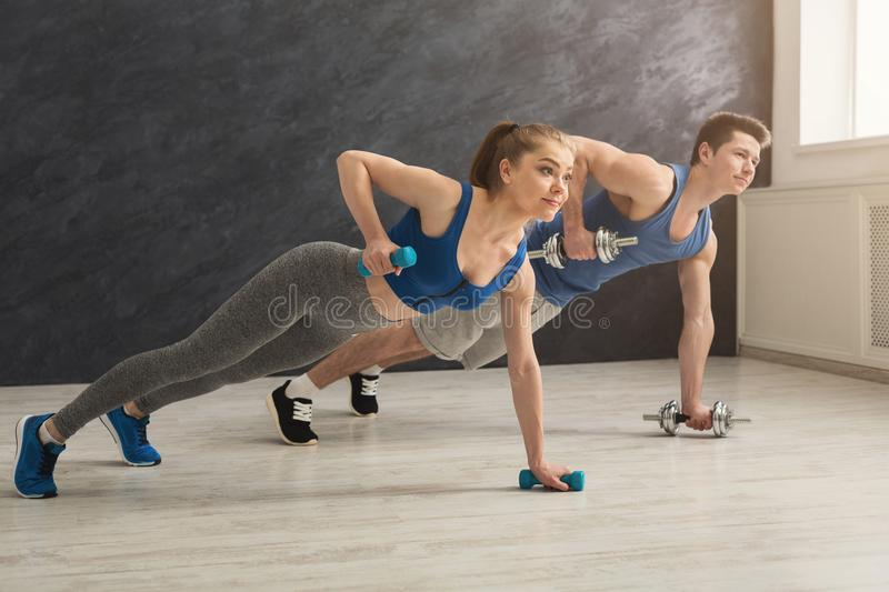 Couple making plank or push ups exercise indoors stock photos