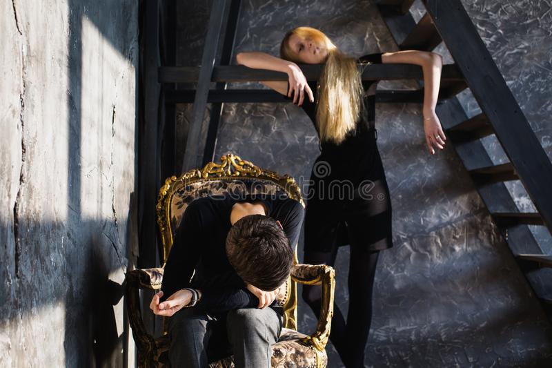 The difficult situation in life. Conceptual photography. A young men and young blonde women with long hair. Problems and difficulties in relations. Difficult stock images