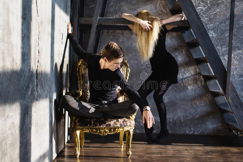 The difficult situation in life. Conceptual photography. A young men and young blonde women with long hair. Problems and difficulties in relations. Difficult royalty free stock image