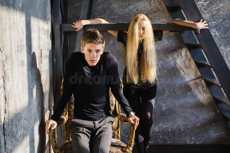 The difficult situation in life. Conceptual photography. A young men and young blonde women with long hair. Problems and difficulties in relations. Difficult stock photography
