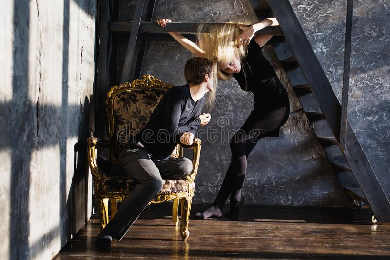 The difficult situation in life. Conceptual photography. A young men and young blonde women with long hair. Problems and difficulties in relations. Difficult royalty free stock photo