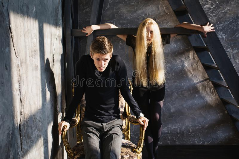 Difficult situation in life. Conceptual photography. A young men and young blonde women with long hair. Problems and difficulties in relations. Difficult royalty free stock images