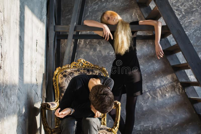 Difficult situation in life. Conceptual photography. A young men and young blonde women with long hair. Problems and difficulties in relations. Difficult royalty free stock photos