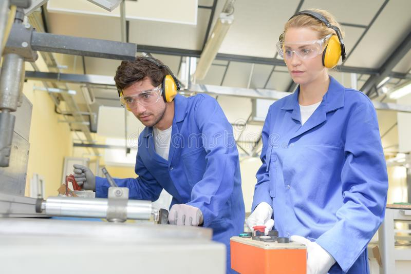 Young metallurgists at work in school workshop royalty free stock photo
