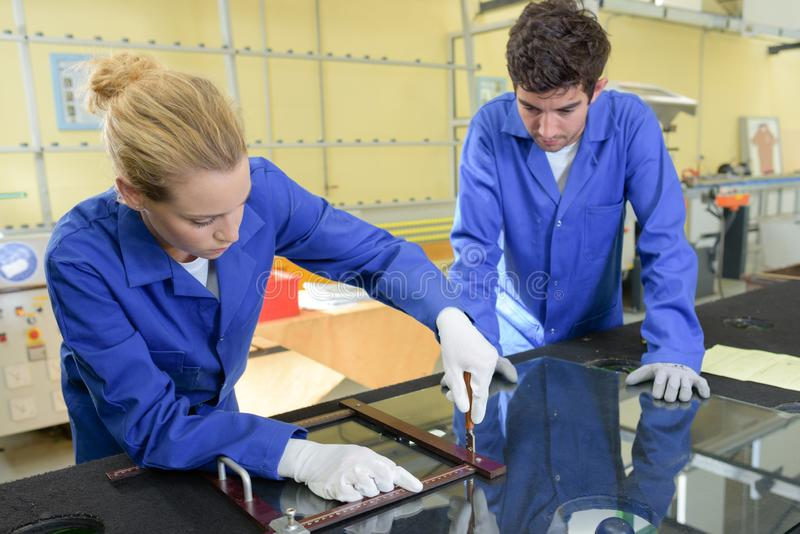 Young metallurgists at work in school workshop stock image