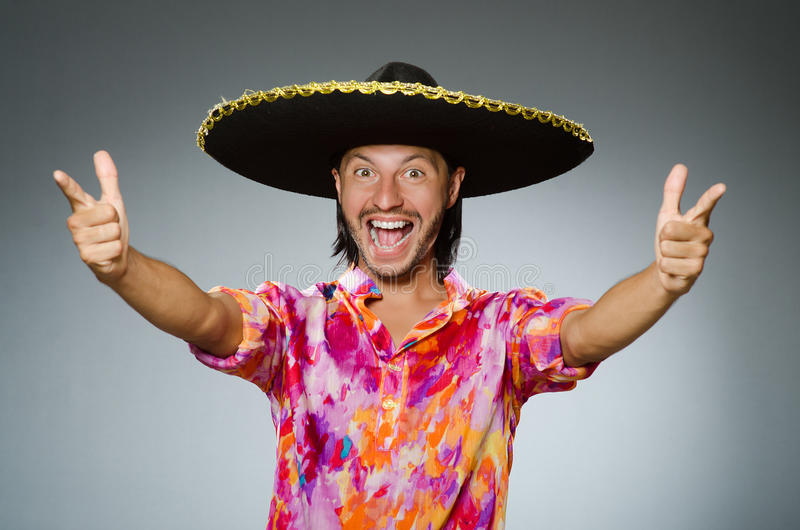 Young mexican man wearing sombrero stock image