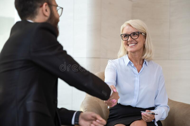 Multi-racial businesspeople starting business meeting or job interview handshaking stock images