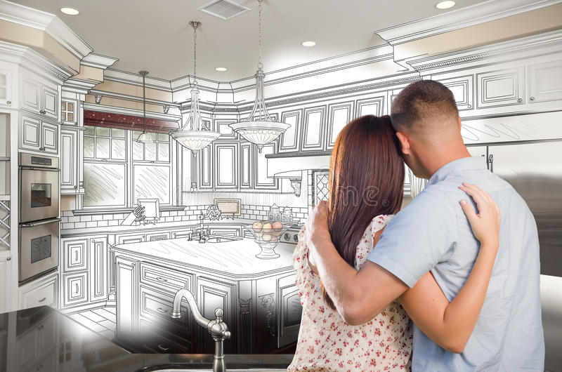 Young Military Couple Inside Custom Kitchen and Design Drawing C stock photo