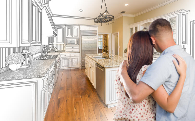Young Military Couple Inside Custom Kitchen and Design Drawing C stock photography