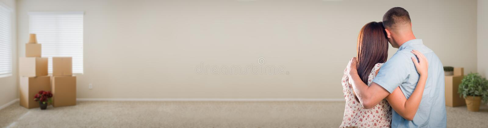 Young Military Couple Looking Inside Room with Boxes Banner. Sweet Young Military Couple Looking Inside Room with Boxes Banner royalty free stock images