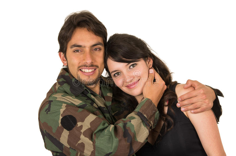 Young military soldier returns to meet his wife royalty free stock photo