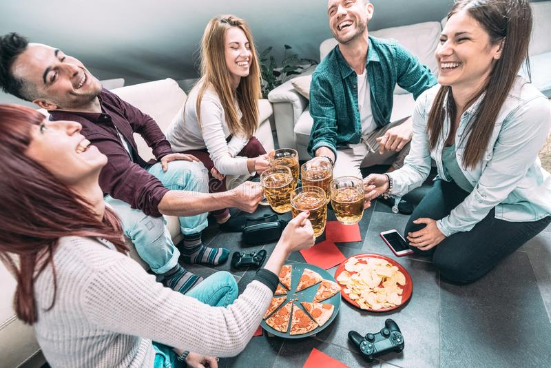 Young millenial friends eating pizza at home after college - Friendship concept with roomates students enjoying time together stock images