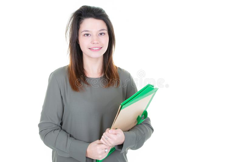 Young millennial pretty girl college student holding folder paper on white background royalty free stock photos