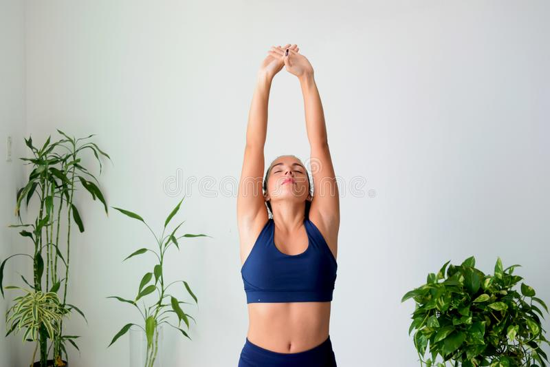 Young woman doing yoga at home royalty free stock photo