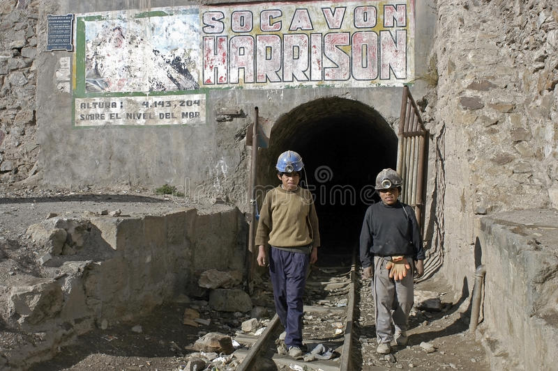 Young miners, child labor in Huanuni, Bolivia. BOLIVIA, city Huanuni, group portrait of Indian boys and miners at the entrance to the mine shaft [Corporacion royalty free stock photography