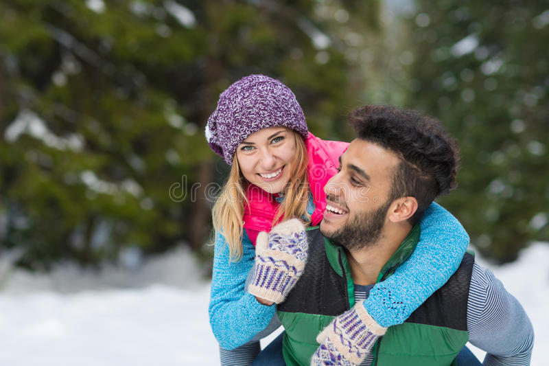 Young Mix Race Couple Embrace Snow Forest Outdoor Winter Walk. Pine Woods stock photos