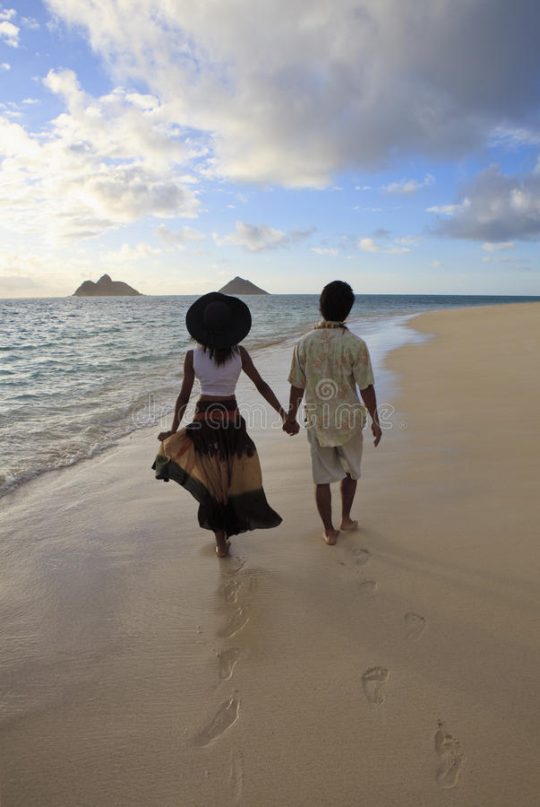 Free Young Mixed Couple Walk On A Beach Royalty Free Stock Image - 15296846