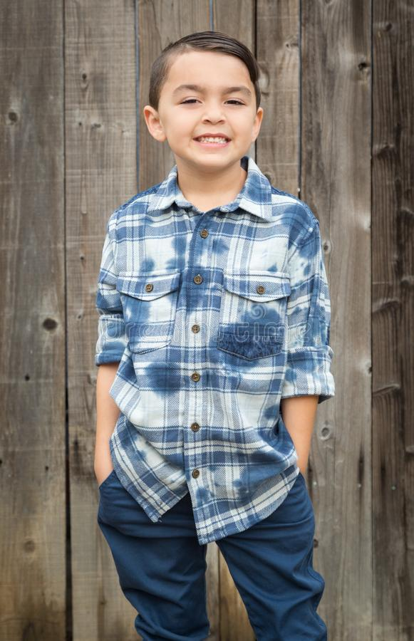 Young Mixed Race Boy Portrait Against Fence. Happy Young Mixed Race Boy Portrait Against Wooden Fence royalty free stock image