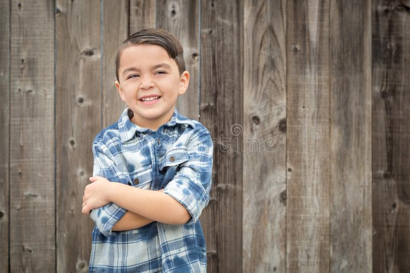 Young Mixed Race Boy Portrait Against Fence. Happy Young Mixed Race Boy Portrait Against Wooden Fence stock photo