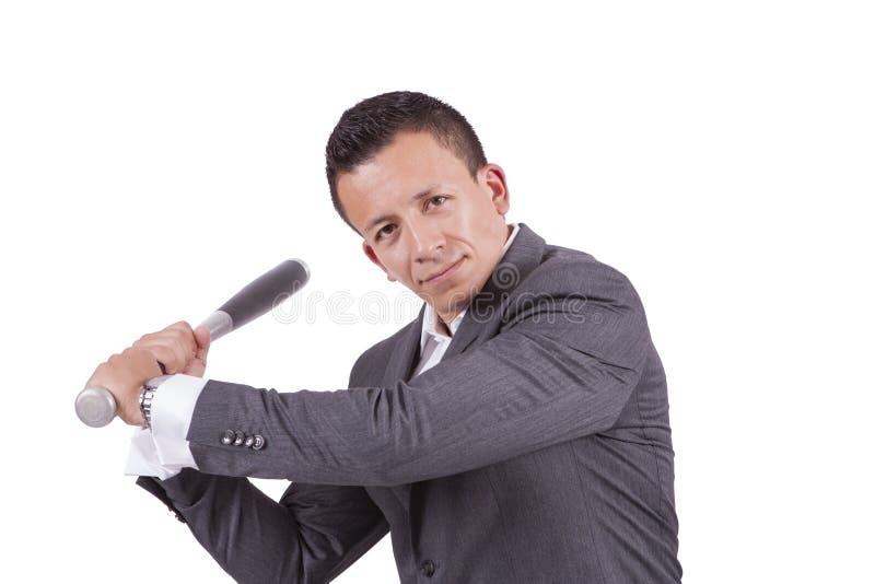 Young mixed race businessman swinging his baseball bat royalty free stock photography