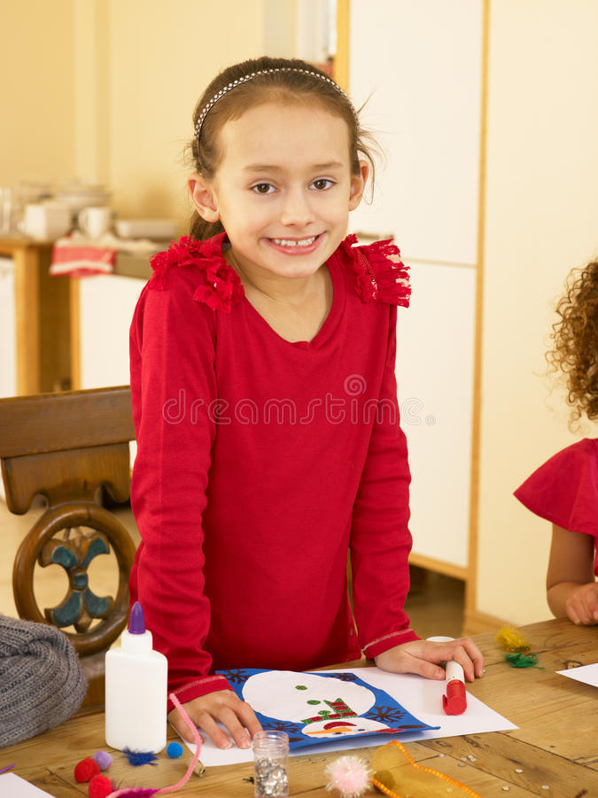 Download Young Mixed Race Child Making Christmas Cards Stock Image - Image: 20466999