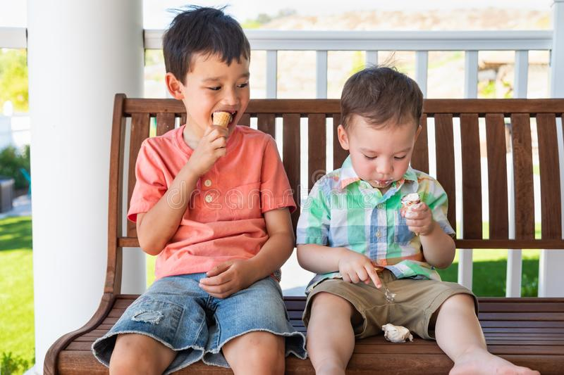 Young Mixed Race Chinese Caucasian Brother Drops His Ice Cream royalty free stock photo