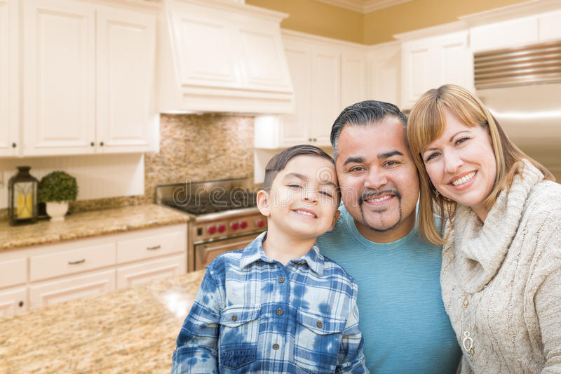 Young Mixed Race Family Having in Beautiful Custom Kitchen. Young Mixed Race Family Having in a Beautiful Custom Kitchen stock images