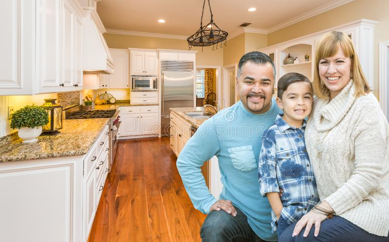 Young Mixed Race Family Having Fun in Custom Kitchen. Happy Young Mixed Race Family Having Fun in Custom Kitchen royalty free stock image