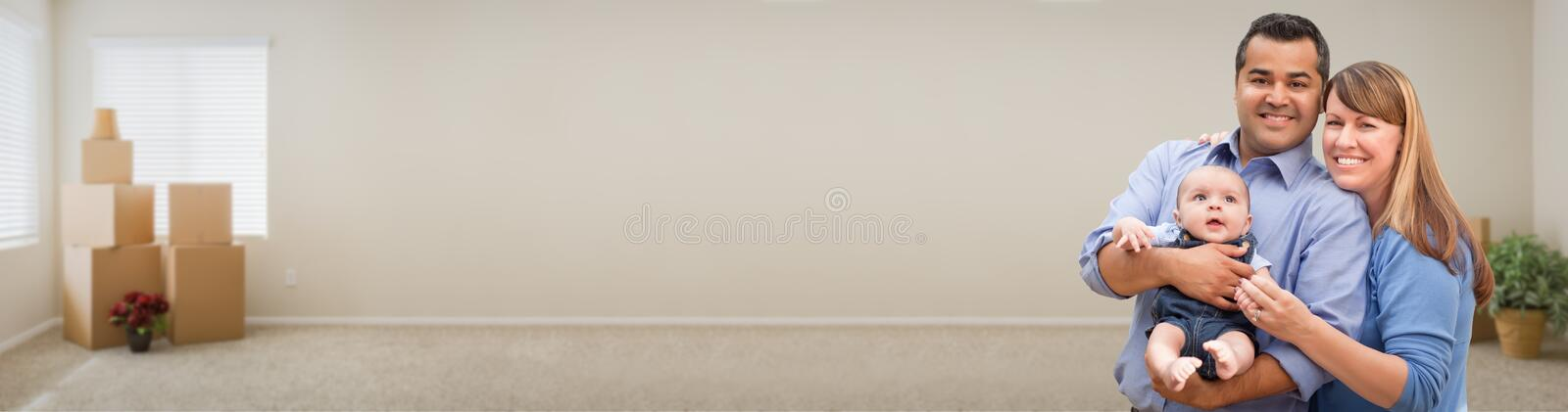 Young Mixed Race Family Inside Room with Boxes Banner. Mixed Race Family Inside Room with Boxes Banner royalty free stock photos