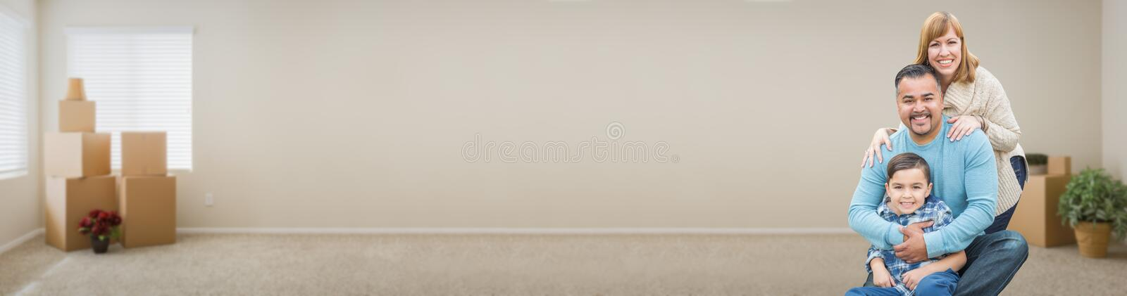 Young Mixed Race Family Inside Room with Boxes Banner. Mixed Race Family Inside Room with Boxes Banner royalty free stock photo