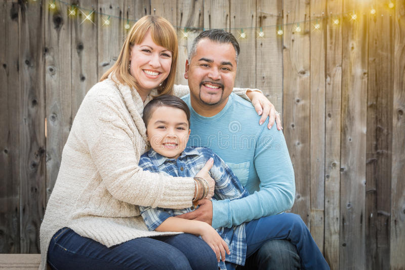 Young Mixed Race Family Portrait Outside. Happy Young Mixed Race Family Portrait Outside stock photography