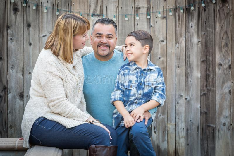 Young Mixed Race Family Portrait Outside. Happy Young Mixed Race Family Portrait Outside stock images