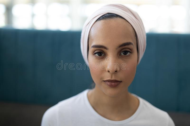 Young mixed-race female executive standing in the lobby at office royalty free stock photography