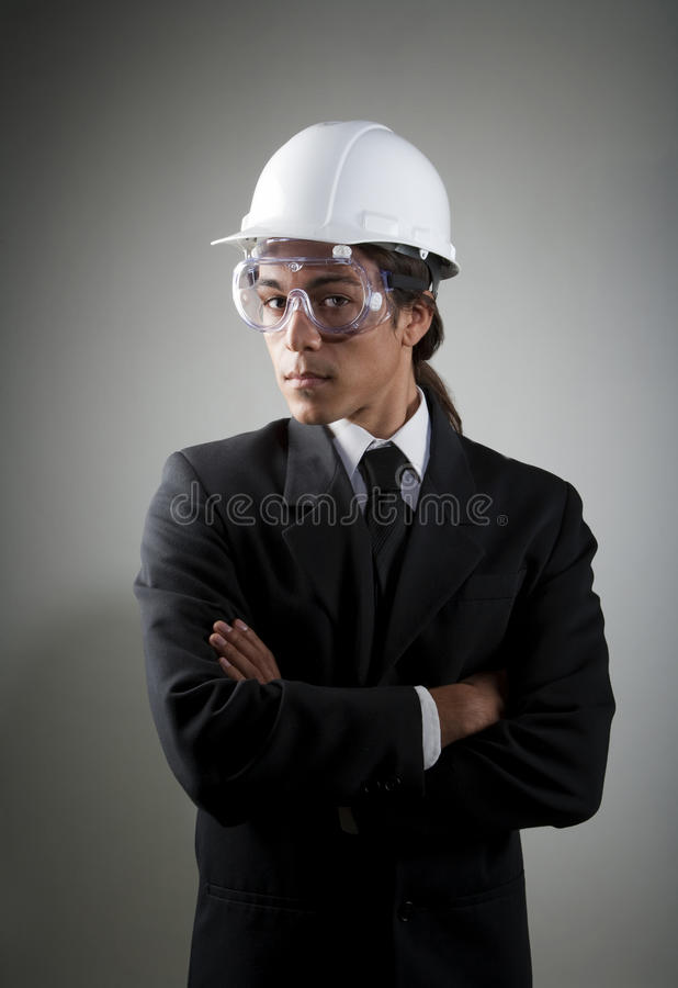 Young mixed race man in hard hat and safety goggle stock photos