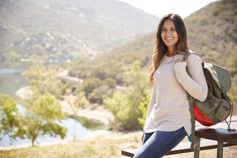 Young mixed race woman during a break while hiking, portrait stock photos