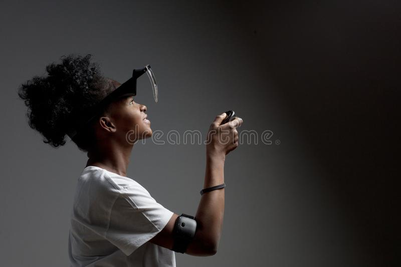 Young mixed race woman wearing virtual reality VR headset on white background. royalty free stock photo