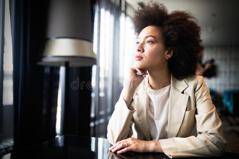 Young woman with afro hairstyle smiling in urban background royalty free stock photos
