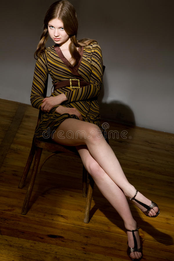 Young model classic studio portrait with chair royalty free stock photos